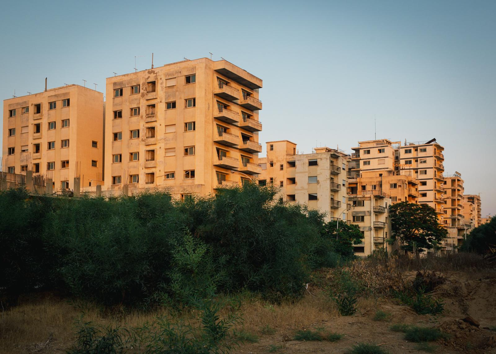 Abandoned apartment buildings on the outskirts of the ghost town.