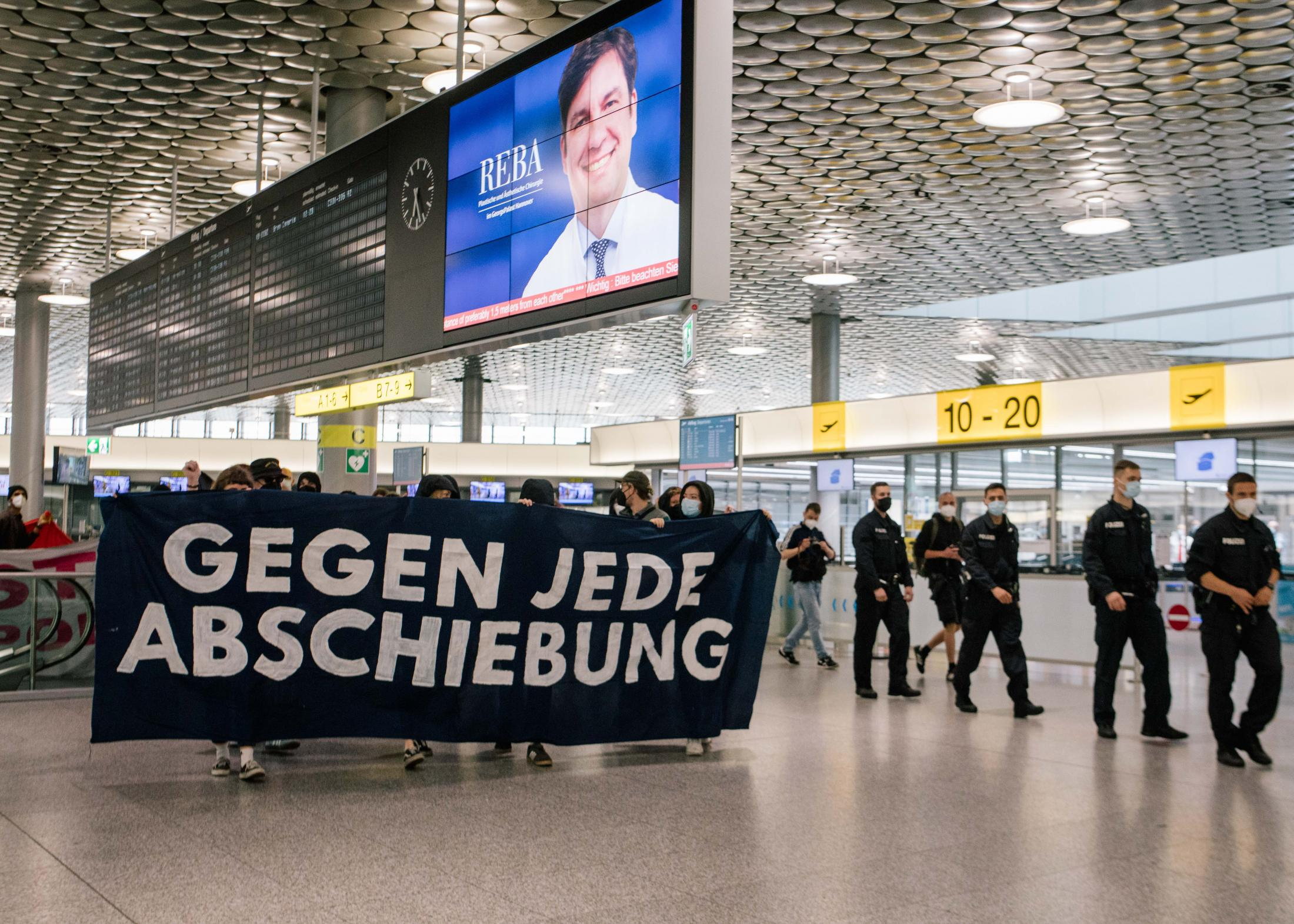 Againstevery deportations read a banner carried by activists at a protest against a deportations through Hanover airport. July 6th, 2021