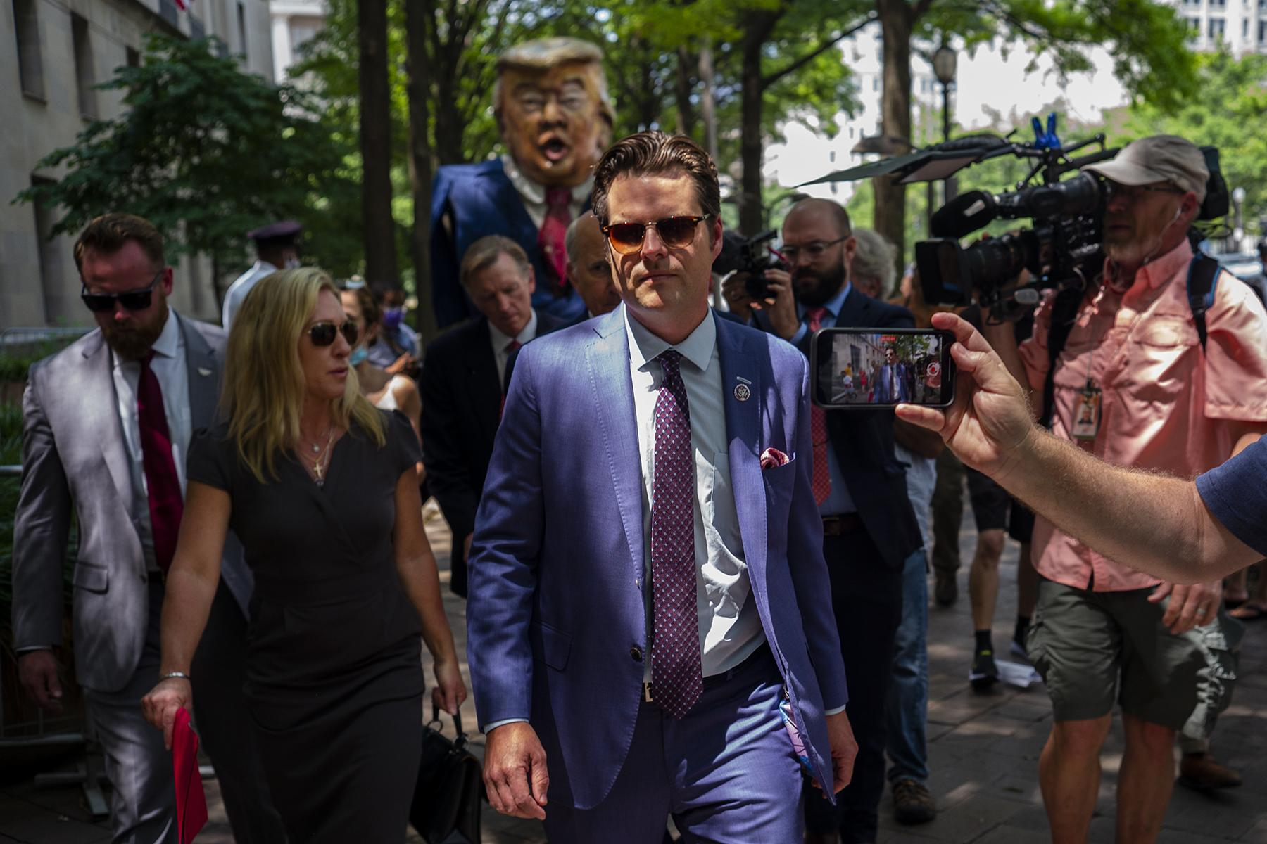Matt Gaetz and Taylor Greene walk to an outside press conference in front of the Department of Justice on July 27th. There were protesting the non-response to questions of status of the investigation related to January 6th by AG Garland.