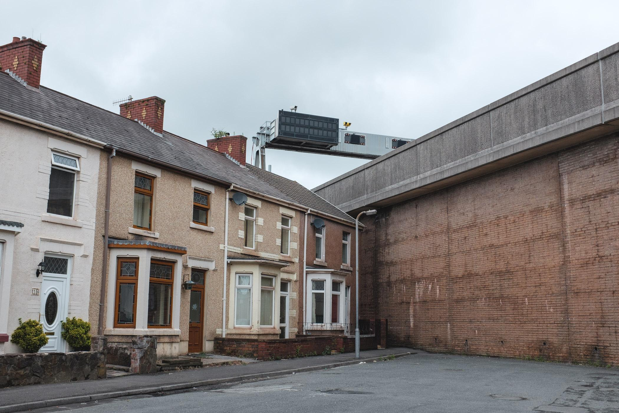 Pont Street, Port Talbot. Over 200 homes, 3 churches and several schools were destroyed to build the M4 bypass in Port Talbot. Those previously living in quiet terraces were faced with living directly against the new motorway, dealing with noise and pollution