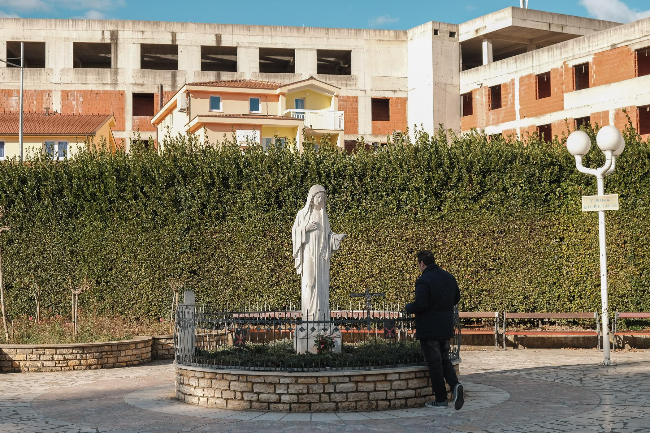 A statue of the Virgin Mary outside the Church of Saint James in Medjugorje, Bosnia and Herzegovina. The town has become a major Catholic pilgrimage site since 1981, when six local teenagers reported being visited by an apparition of the Virgin while walking on a hill overlooking the town.