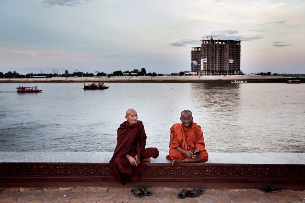 Monks are sitting where the Tonle Sap and Mekong rivers meet, Phnom Penh, Cambodia.