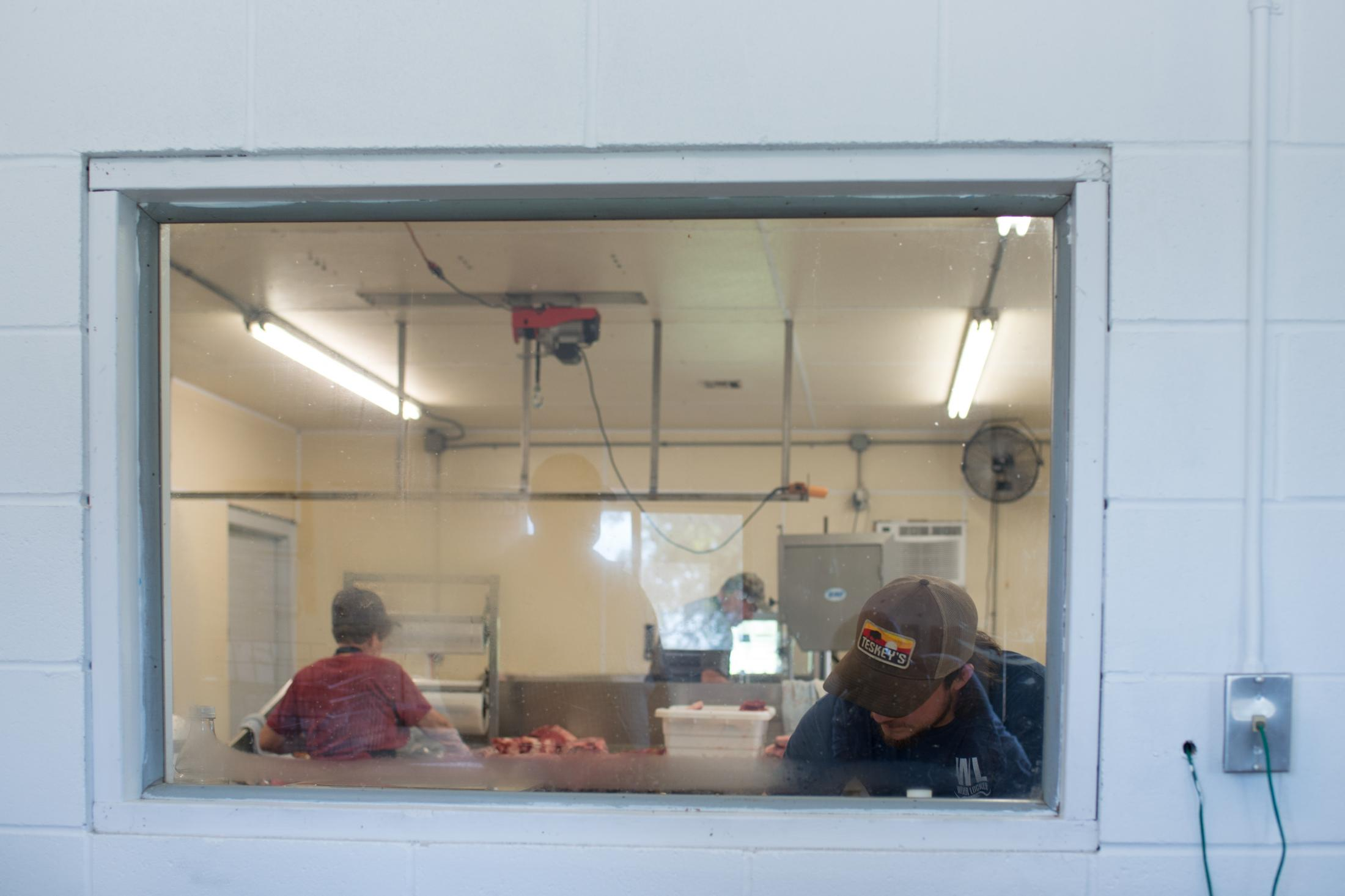 Employees process meat inside a meat processing facility in Wever, Iowa, on Tuesday, Aug. 24, 2021. Last year, almost 5 million hides, or about 15 percent of all available hides, ended up in landfills because Americans still kill plenty of cattle for their meat. But their hides increasingly have nowhere to go.