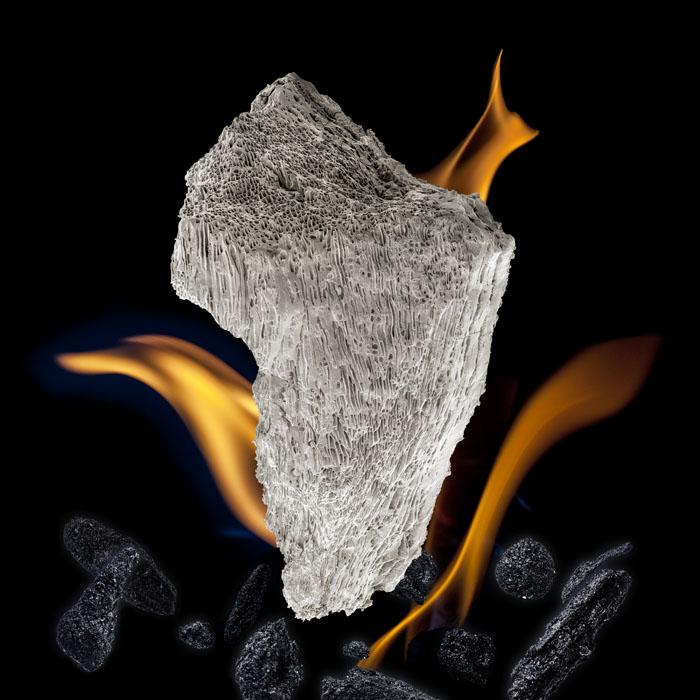 """BIOCHAR The addition of biochar to soils, if done correctly, greatly increases the capacity of soils to hold water, nutrients and carbon. Use of biochar can be a """"carbon negative"""" process. The central biochar in this image is the size of a pinhead, and the crystalline, porous surface hints at its sponge-like qualities."""