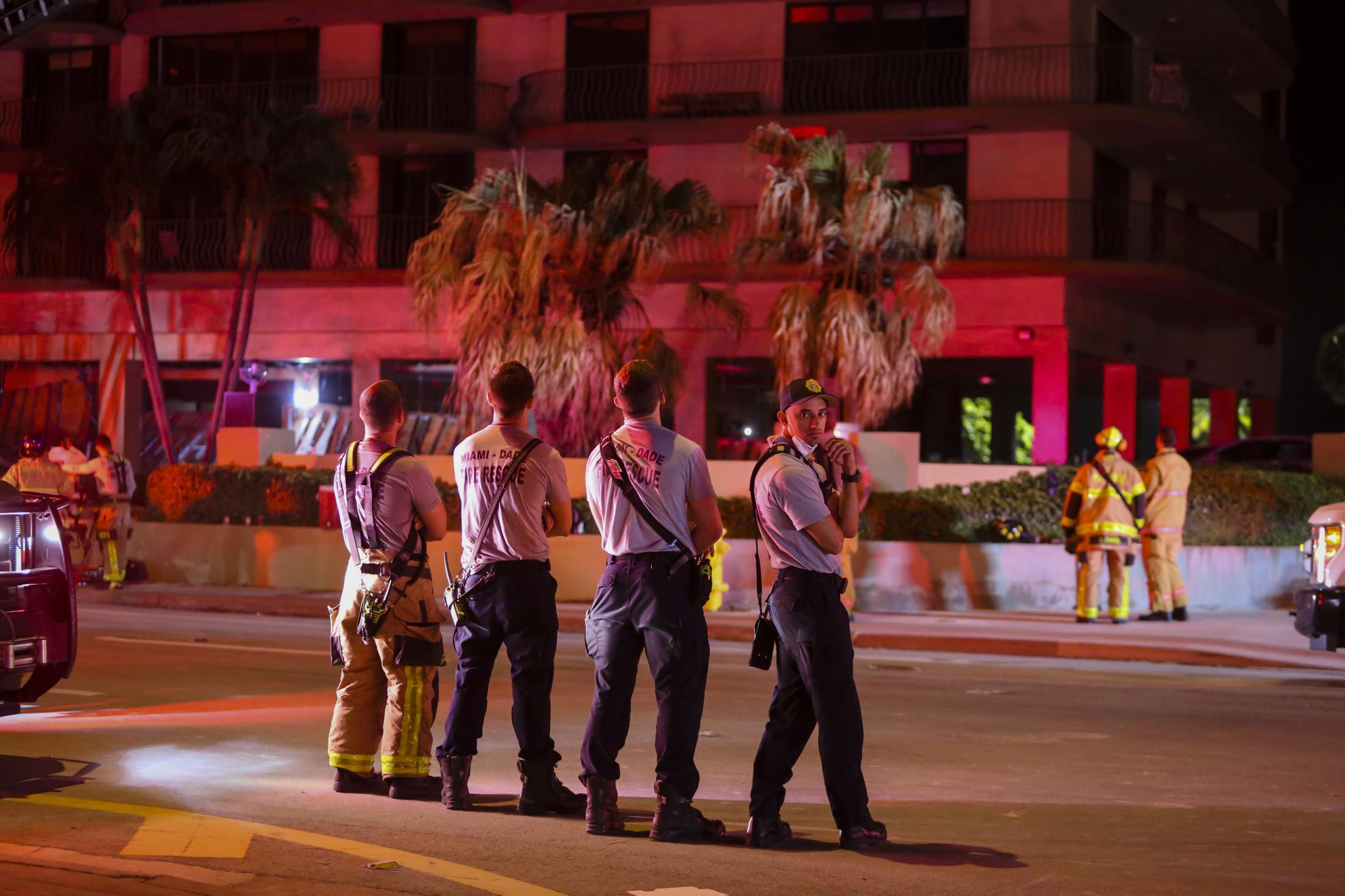 Rescue workers gather on the street during a building partially collapse rescue operation in Surfside, Florida, U.S., on Thursday, June 24, 2021. Photographer: Eva Marie Uzcategui/Bloomberg in Surfside, Florida, U.S., on Thursday, June 24, 2021. Photographer: Eva Marie Uzcategui