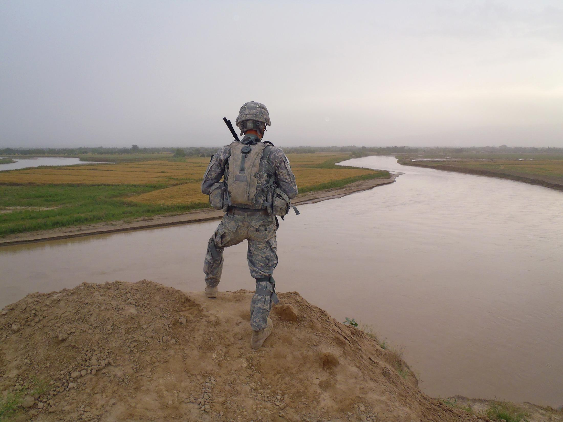 I met John through mutual friends in 2011, shortly after he returned from a combat deployment in Afghanistan. John, who was his unit's unofficial photographer, took this photo of Private First Class Michalik taking in the view in Kunduz, Afghanistan. PHOTOGRAPH BY JOHN PRINCIPE