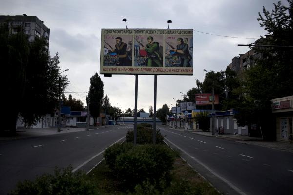 A sign in the middle of Donetsk city, showing how does DPR leadership (Donetsk Peoples Republic) views the current conflict in E Ukraine.