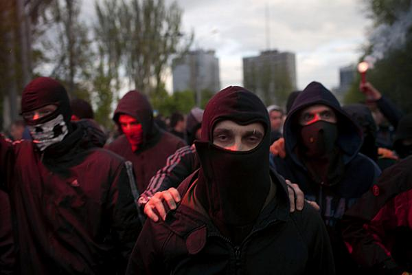 Pro-Ukraine activist holds a flare during a pro Ukraine rally in Donetsk.
