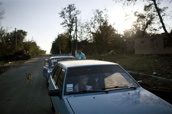 A family with their belongings leaving the village of Stefanovka, which was the scene of heavy fighting between UA army and Donetsk people militia.