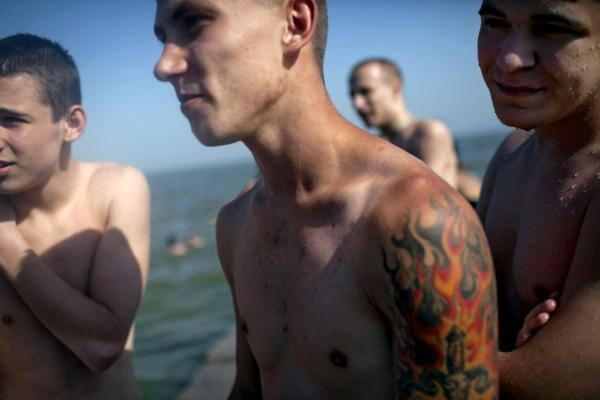 Young boys from the city of Mariupol, which was the scene of fighting between DNR (Dontesk People Republic) forces and the UA army, taking the day off in the beach.