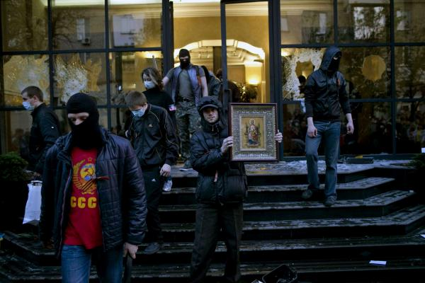 Pro-Russian activists looting the offices of Industrial Union of Donbass Corporation in Donetsk city.