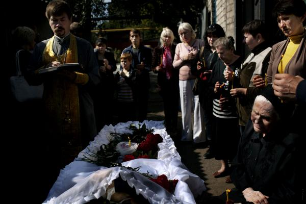 The funeral proccesion of Victor Chyuyokov (78), who died from shelling with five more civilans, on September 14, near his home during a shelling dual bettwen the Ukrainan army and the DPR, near Donetsk airport.
