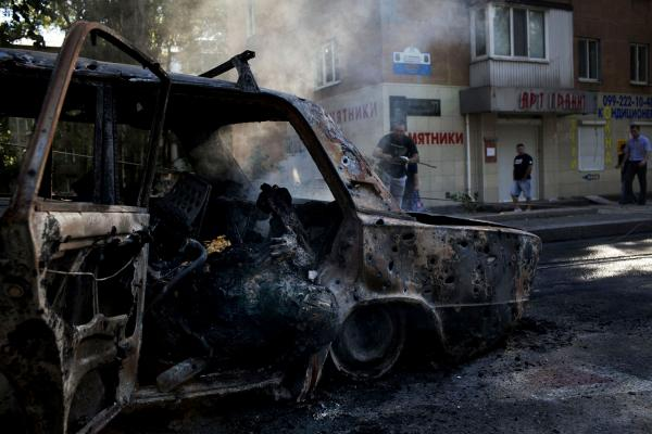 The bodies of three family members, lying dead in their burned car after heavy shelling in Donetsk city.