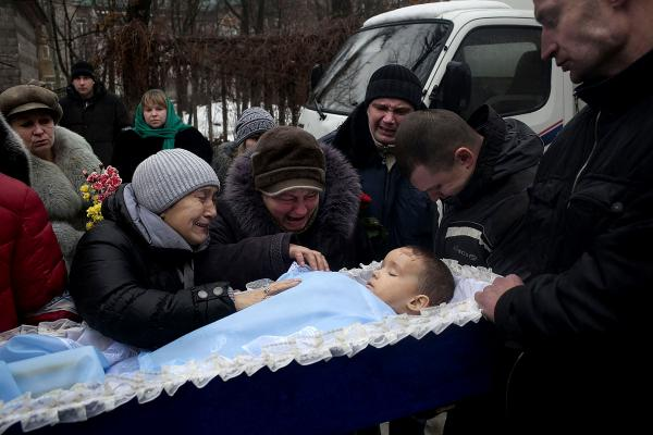he funeral procession of Artyom Boboshian, Age 4, who was killed in an artillery strike on his home in Donetsk.