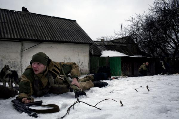 A DPR soldier, takes cover, during an artillery barge on his position on the frontline, near Gorlivka, E Ukraine.