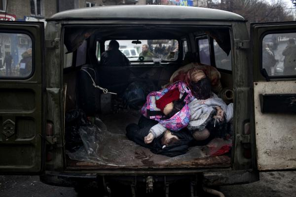 Bodies are being pilled up in the a morgue van after a mortar attack on a residential bus in the city of Donetsk, which has left 8 people dead and many wounded.