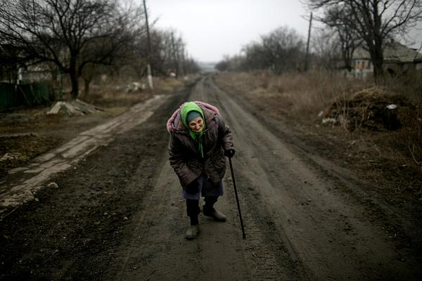 Sonya, aged 78, one of the last 11 civilians living in the village of Pisky, heading back to her home after talking to Ukrainian army soldiers. population of the village before the war is estimated at 3000 people.