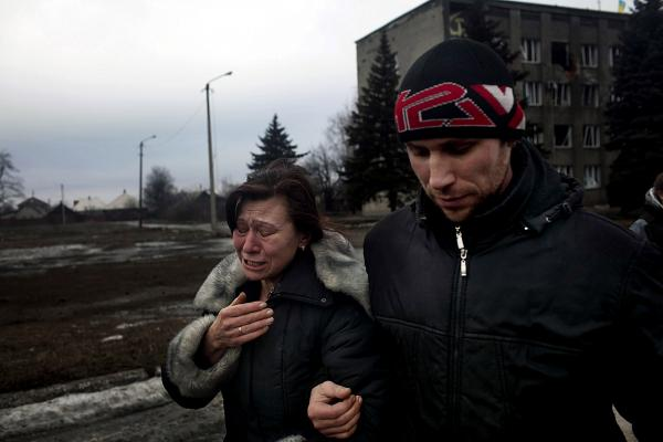 Family members of people who had to flee from the city of Debaltseve, crying after their relatives left on a bus. Debaltseve was a scene of heavy fighting between UA army and DPR forces, eventually it fell to DPR hands.
