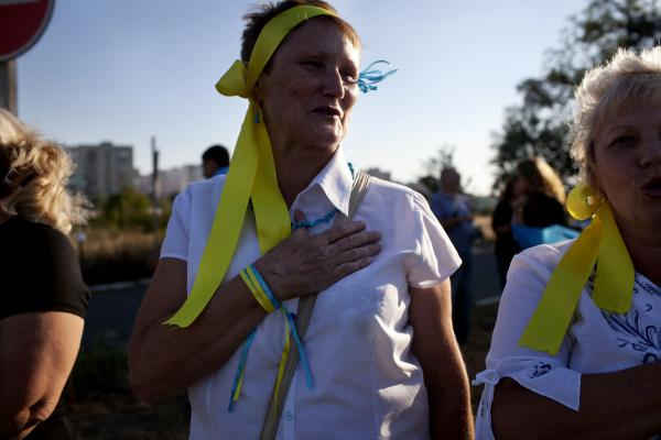 Civilians from the city of Mariupol stage a pro Ukrainian protest near the eastern checkpoint that leads from Mariupol to the city of Novoazovsk, held by Donetsk People's Republic forces.