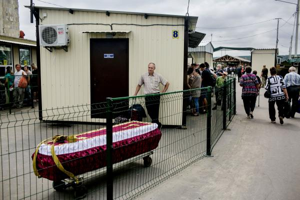 A coffin of a civilian who passed away in LPR (Luhansk People Republic) territory, being transported to the Ukrainian side of the border, in order to be buried there. Stanitsia Luhanskia crossing check point. one of the border crossing between the two sides.