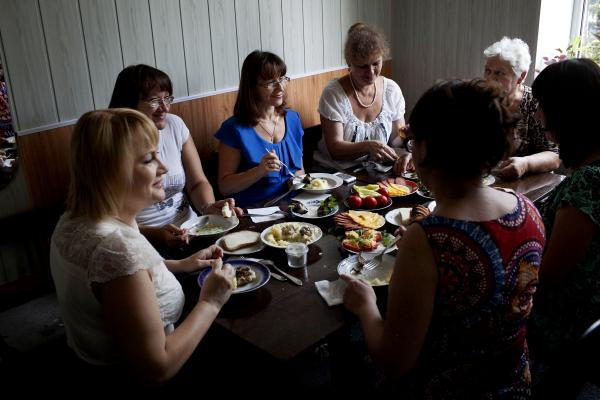 Members of the Jewish community having lunch in the main Jewish centre in the city of Kramatorsk, after it was captured by UA army from Donetsk People's Republic forces,