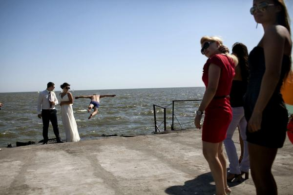 Residents of the city of Mariupol celebrating a wedding at the beach, the city was the scene of heavy fighting between Donetsk Peoples Republic forces and UA army, and for now is being controls by the UA army,