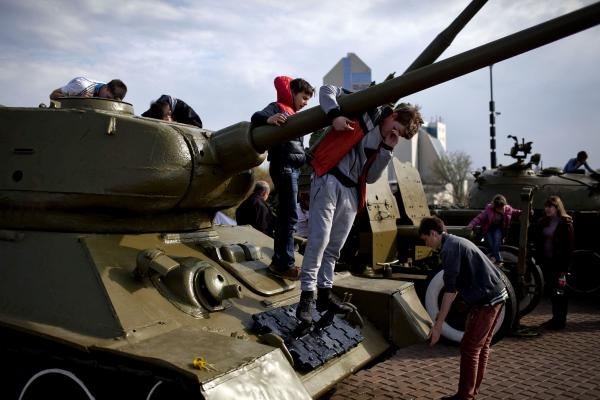 Children playing around the WWII memorial in Donetsk.
