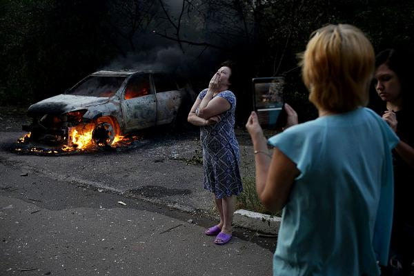Local residents react after shelling of their neighborhood in central Donetsk.