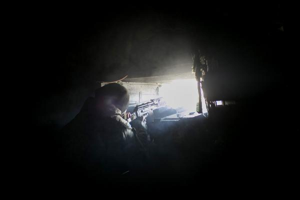 A Ukrainian soldier open fires towards no man's land in between DPR and UA, after a diversion group of DPR soldiers was spotted moving around.