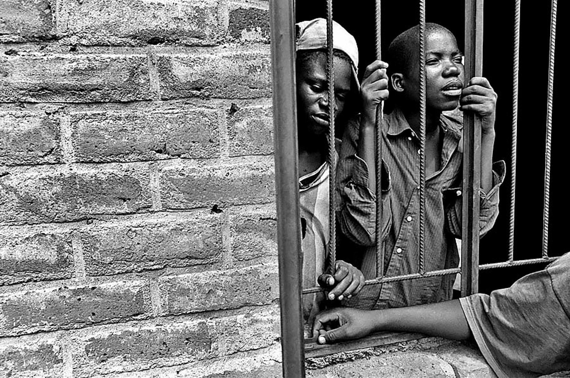 young boys looking through a barge window at namitete, Malawi people of east Africa 6/12/06 CATEGORY #22 FREELANCE