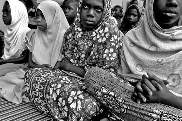 a group of hiv-aids orphans listening to their teacher, Zanzibar 30.11.06 a portrait story about the diversity of east Africa people. CATEGORY #22 FREELANCE