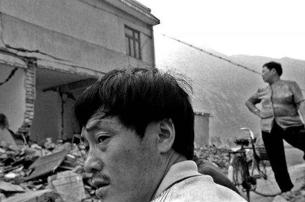 Survivors waiting for their damaged house to be assessed by government officials. Xianwang village, Sichuan province.