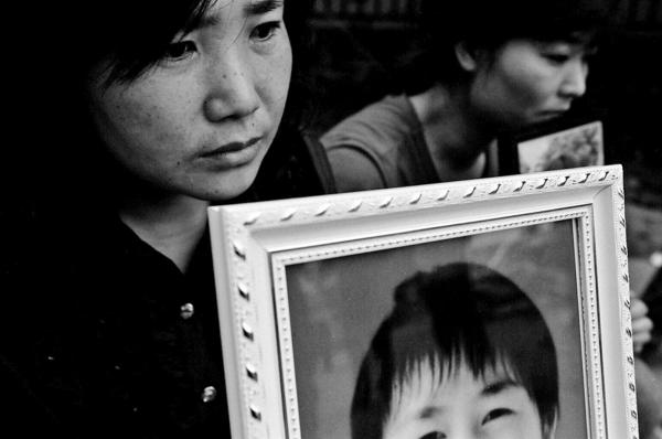 Mothers of children who died while their school collapsed in the quake , staging a protest infant of the school ruins, blaming government officials in reckless building of the school , Juyuan town.