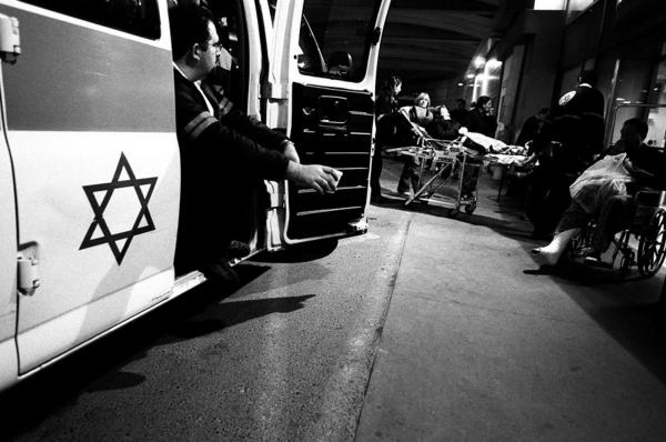 """taking a break between calls at the entrance to the emergency room of """"echilov"""" hospital in tel-aviv israel- 23/5/06 CATEGORY-#23 FREELANCE"""