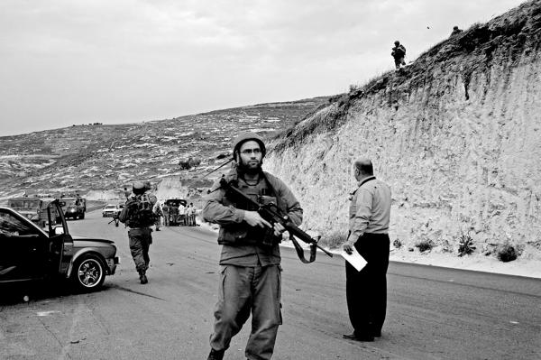 Rservists securing parts of a road, after calling medical personal, as they encounter a car accident between Palestinains and Israelis cars, near Jenin .