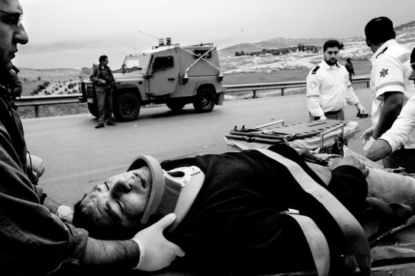 Reservists evacuating an injured Palestine man after a car crash in the West Bank, near Jenin.