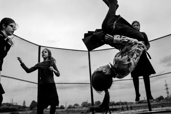 Young Jewish girls from the new school in Anatevka, playing on a trampoline during a break between classes. 50 Jewish children who are IDP's from E Ukraine, are studying in Anatevka School.