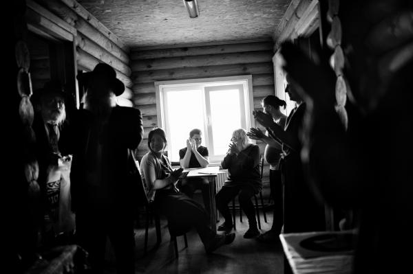"""Local rabbis from Kiev (L), celebrate with idps , after placing Mezuzahs at the entrance of each room, in Anatevka. A mezuzah is a piece of parchment (often contained in a decorative case) inscribed with specified Hebrew verses from the Torah (Deuteronomy 6:4-9 and 11:13-21). These verses compose the Jewish prayer """"Shema Yisrael"""", beginning with the phrase: """"Hear, O Israel, the LORD (is) our God, the LORD is One"""". In mainstream, i.e. Rabbinic Judaism, a mezuzah is affixed to the doorframe of Jewish homes to fulfill the mitzvah (Biblical commandment) to inscribe the words of the Shema """"on the doorposts of your house"""""""