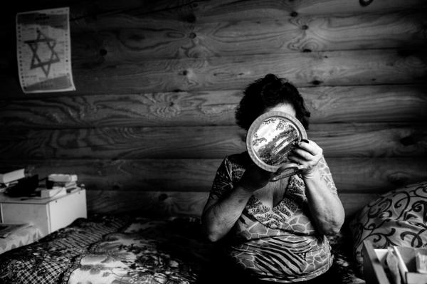 Katia, a Jewish IDP from Luhansk in her room in the living quarters in Anatevka .