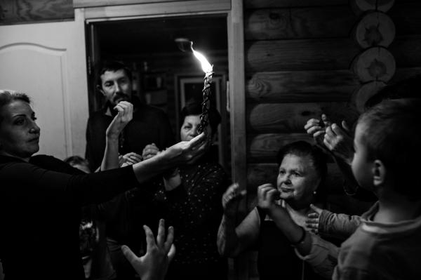 Members of the IDP's Jewish community in Anatevka. performing the Havdalah ceremony- An orthodox Jewish ceremony for the importance of making the difference between the Shabat (which is the holy day in the week of the Jews) and the daily week.