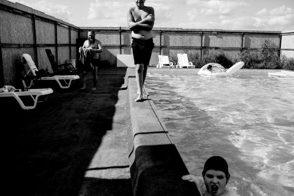 Members of the Jewish community of Kiev and Jewish IDP's from East Ukraine, bathing in a swiming pool that was built in the Village.