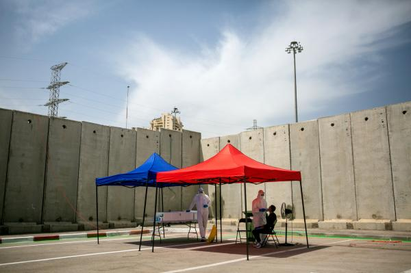 A Covid-19 testing station, at the entrance of Shuafat, in East Jerusalem neigberhood, whose residents are Palestinians, who are alsoIsraeli civilians with an official Israeli ID cards.