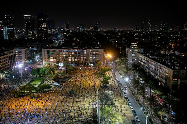 Israelis citizens demonstrate against Prime Minister Benjamin Netanyahu due to his upcoming trial for corruption, keeping two metres apart under coronavirus (Covid-19) restrictions in Tel Aviv, Israel.