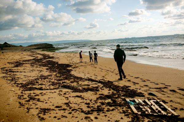 A father and his three children, walking on a beach in Northern Israel, during the first week of the Pandemic.