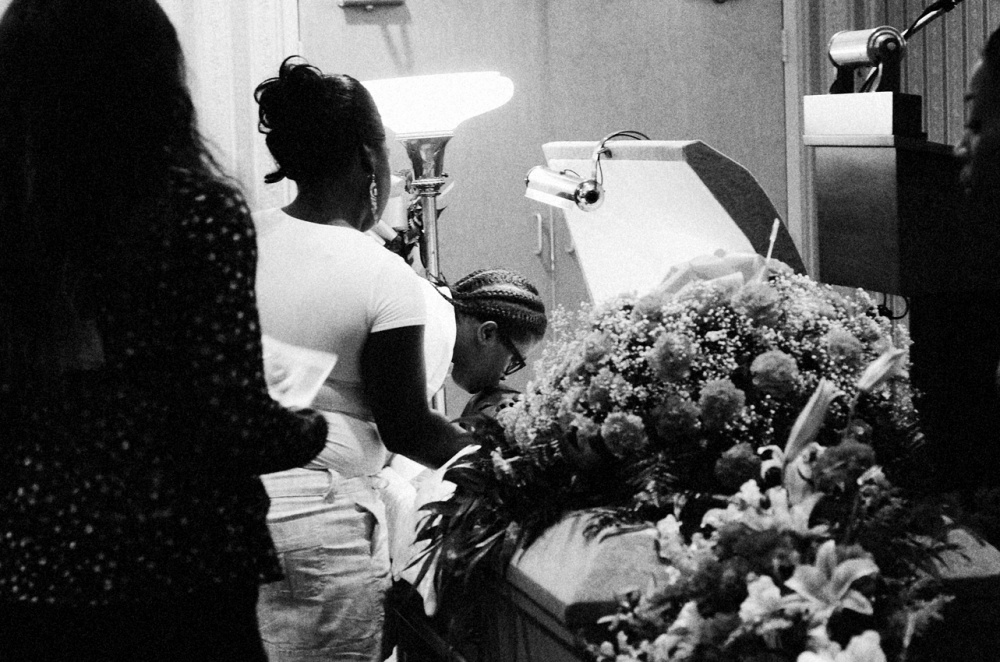 Mourners at the funeral of Davon Ockimey.