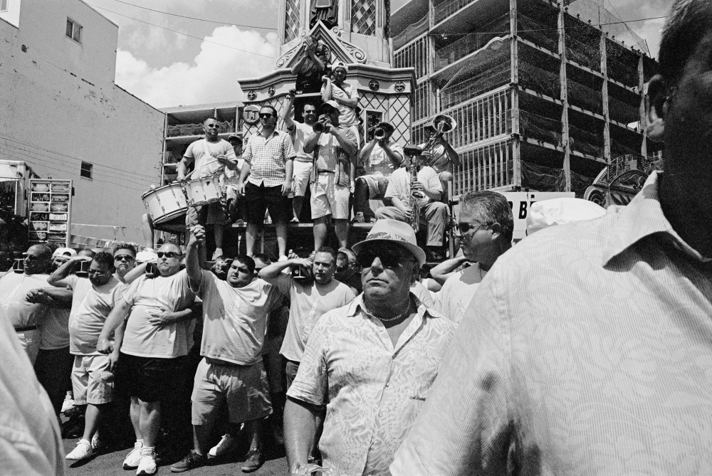 During the Giglio Feast, the men of the community carry the Giglio, a tower almost 20 meters tall. A capo determines the path and pace of the Giglio. Several capos take turns during the course of the procession.