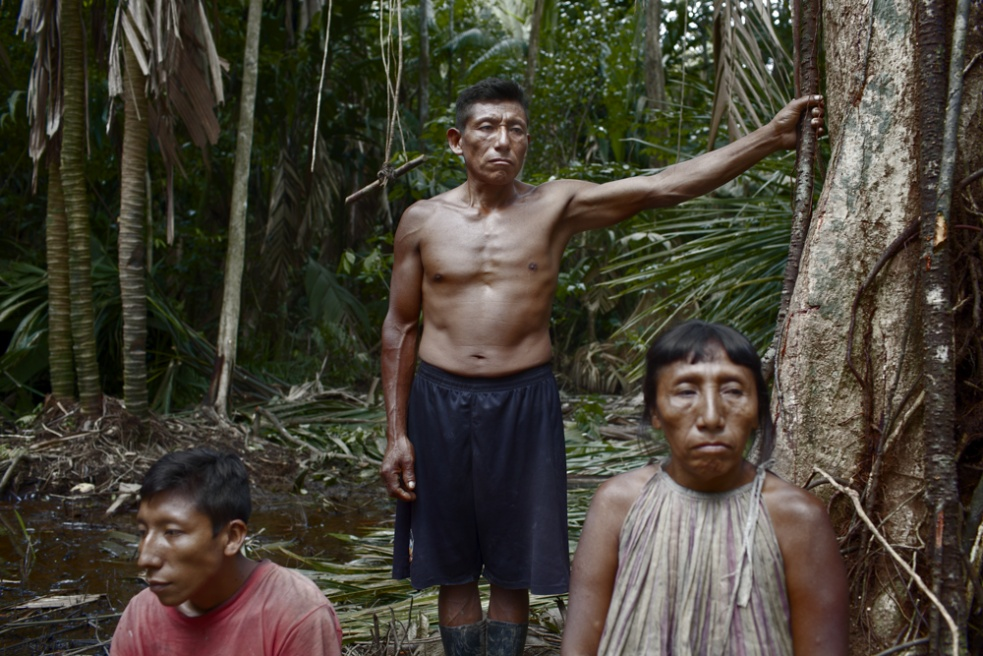 Members of Medina family in their conuco, a small plantantion deep in the jungle where periodically they move and live for several months.
